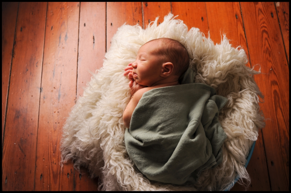 baby sleeping, hardwood floors