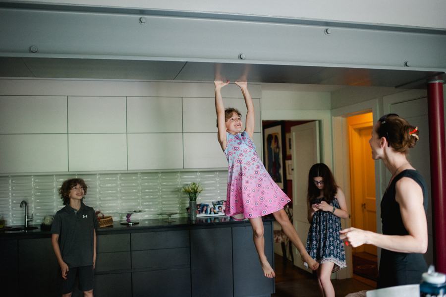 1-girl-swinging-from-kitchen-beam