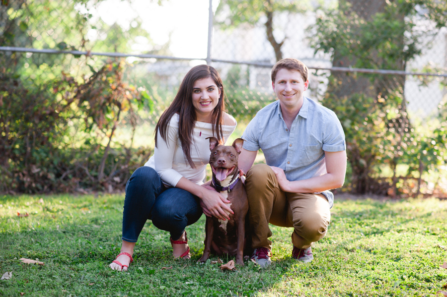 3-couple-in-backyard-with-dog